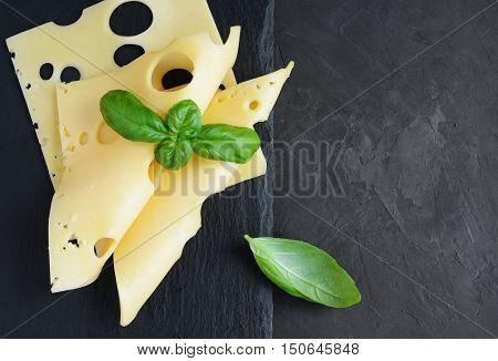 Maasdam Cheese Slices With Fresh Basil