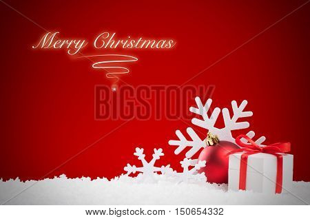 Merry Christmas background with snow and gift box with red ribbon. White snowflakes and red xmas ball with copy space. Christmas decoration with red shiny background.