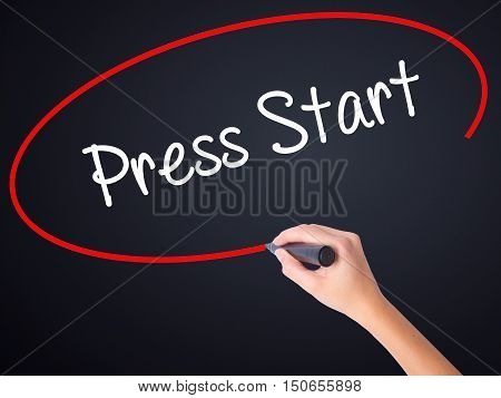 Woman Hand Writing Press Start With A Marker Over Transparent Board