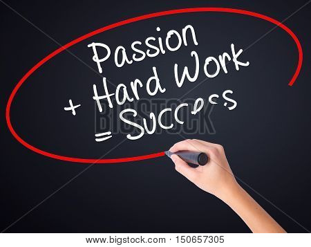 Woman Hand Writing Passion + Hard Work = Success With A Marker Over Transparent Board