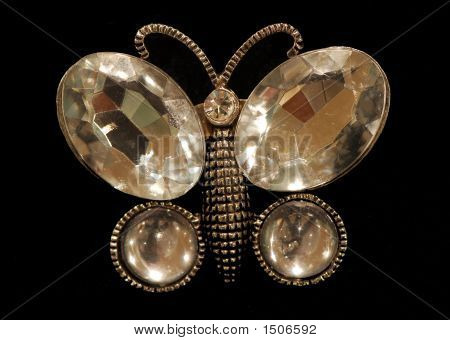 glass butterfly jewelry isolated on black background poster