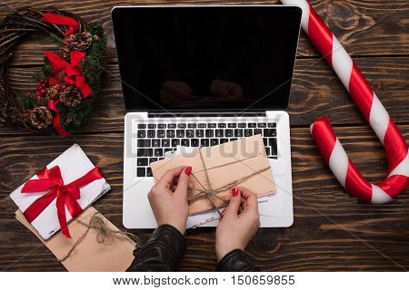 Christmas Background. Laptop With Blank Screen. The Girl's Hands Doing A Bow The Letter