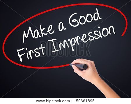 Woman Hand Writing Make A Good First Impression With A Marker Over Transparent Board