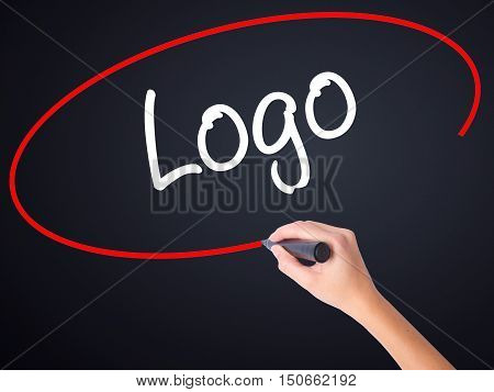 Woman Hand Writing Logo  With A Marker Over Transparent Board