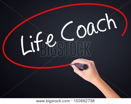 Woman Hand Writing Life Coach With A Marker Over Transparent Board