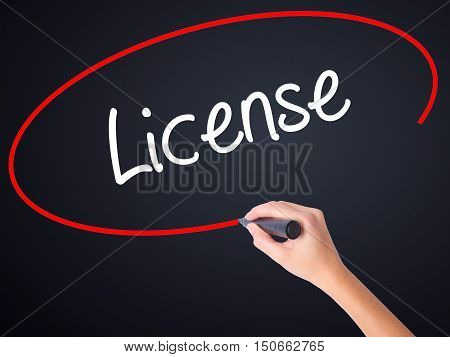 Woman Hand Writing License With A Marker Over Transparent Board