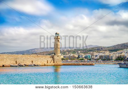Rethymno old Venetian harbor with the Egyptian lighthouse, Crete island, Greece. It was built in 1830 by Egyptians.