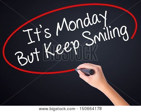 Woman Hand Writing It's Monday But Keep Smiling With A Marker Over Transparent Board