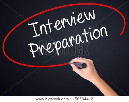 Woman Hand Writing Interview Preparation With A Marker Over Transparent Board