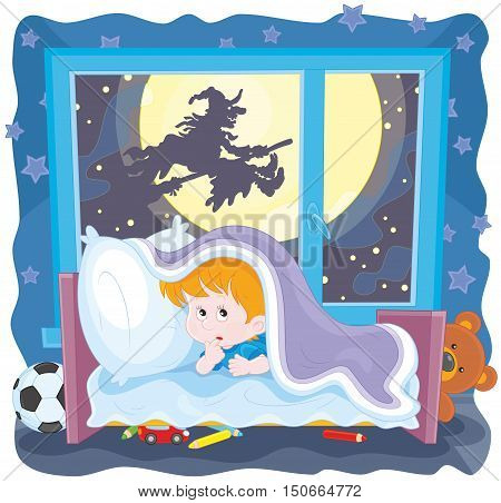 The Halloween night, a little boy in fear hiding under the blanket in his bed, a witch flying on her broom outside the window
