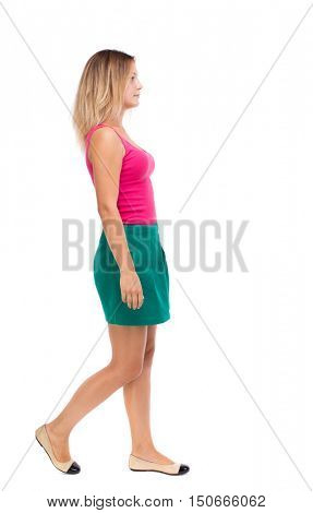 back view of walking  woman. beautiful girl in motion.  backside view of person.  Rear view people collection. Isolated over white background. Girl in a green skirt is in the side.