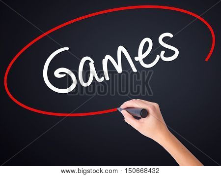 Woman Hand Writing Games With A Marker Over Transparent Board