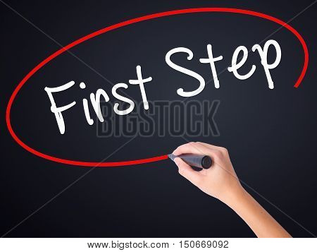 Woman Hand Writing First Step  With A Marker Over Transparent Board