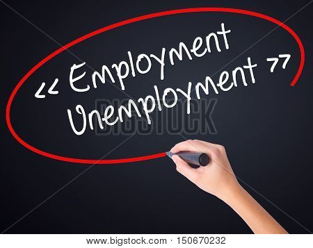 Woman Hand Writing Employment - Unemployment With A Marker Over Transparent Board .