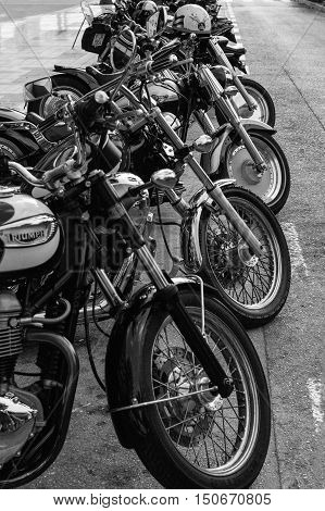 ALICANTE SPAIN - SEPTEMBER 25 2016: Collection of motorcycles are parked on the Distinguished Gentleman's Ride day a global fundraiser for prostate cancer and men's health investigation. White and black.