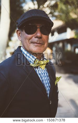 ALICANTE SPAIN - SEPTEMBER 25 2016: Close up of a middle aged man dressed in dapper styles is looking at the camera on the Distinguished Gentleman's Ride day a global fundraiser for prostate cancer and men's health investigation