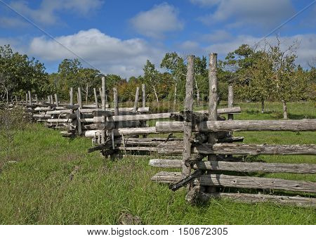 Old wooden fence in the country on a fall day