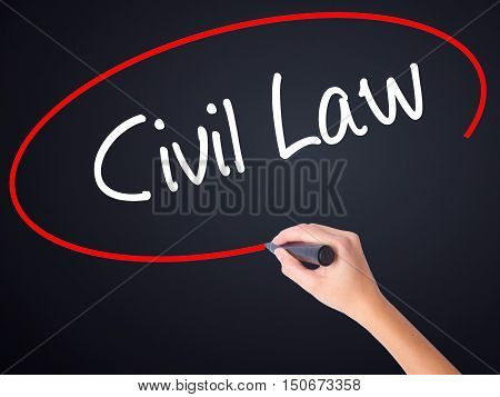 Woman Hand Writing Civil Law With A Marker Over Transparent Board