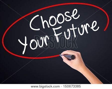 Woman Hand Writing Choose Your Future With A Marker Over Transparent Board