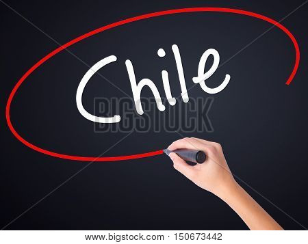 Woman Hand Writing Chile  With A Marker Over Transparent Board
