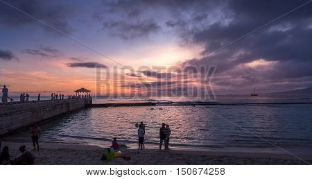 HONOLULU, USA - AUG 8: Pier on Waikiki beach at night on August 8, 2016 in Honolulu, Usa. Waikiki beach is neighborhood of Honolulu, best known for white sand and surfing.