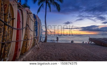 HONOLULU, USA - AUG 8: Surf rental shop on Waikiki beach at night on August 8, 2016 in Honolulu, Usa. Waikiki beach is neighborhood of Honolulu, best known for white sand and surfing.