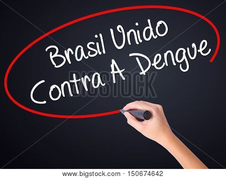 Woman Hand Writing Brasil Unido  Contra A Dengue (brazil Against Dengue In Portuguese) With A Marker