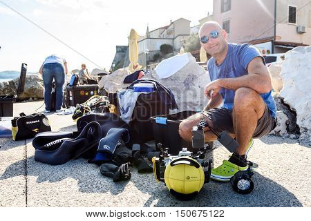 Piran Slovenia - September 24 2016: DRM Open - underwater photography splash-in competition in Slovenia. Underwater photographers are setting up photographic and diving equipement for scuba diving.
