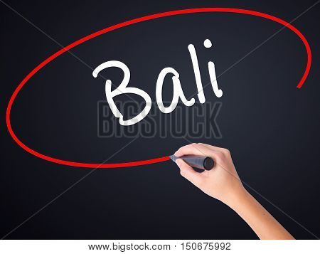 Woman Hand Writing Bali  With A Marker Over Transparent Board