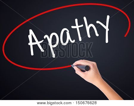 Woman Hand Writing Apathy  With A Marker Over Transparent Board