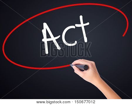 Woman Hand Writing Act With A Marker Over Transparent Board .