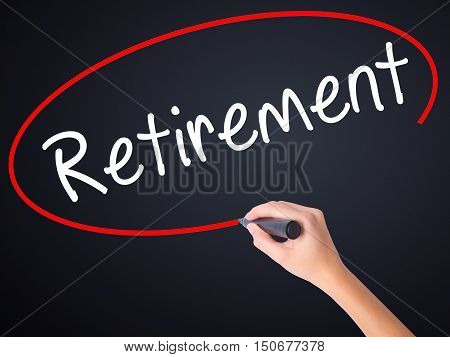 Woman Hand Writing Retirement With A Marker Over Transparent Board