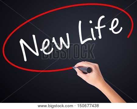 Woman Hand Writing New Life With A Marker Over Transparent Board