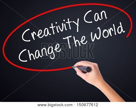 Woman Hand Writing Creativity Can Change The World With A Marker Over Transparent Board