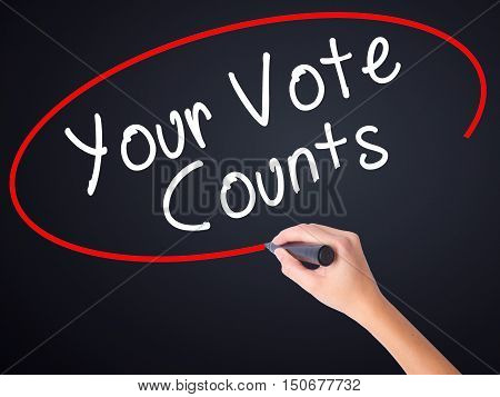 Woman Hand Writing Your Vote Counts With A Marker Over Transparent Board