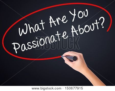 Woman Hand Writing What Are You Passionate About?  With A Marker Over Transparent Board