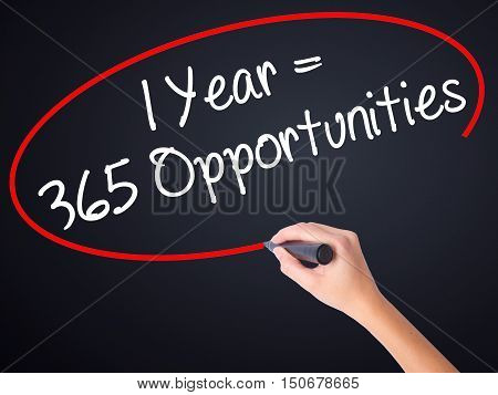 Woman Hand Writing 1 Year = 365 Opportunities With A Marker Over Transparent Board