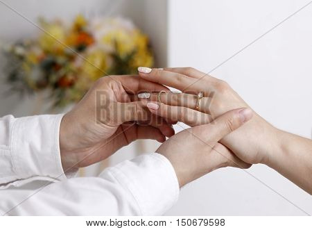 Bride wears a wedding ring to the groom