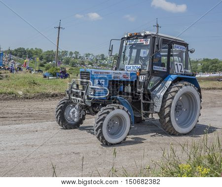 Rostov-on-Don Russia- June 052016: Competition for agricultural tractors on the Bizon Track Show.The demo of the tractor transportation