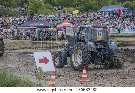 Rostov-on-Don Russia- June 052016: Tractor with a damaged wheel on the Bizon Track Show.Spectators watch the races