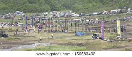 Rostov-on-Don Russia- June 052016: Competition for agricultural tractors on the Bizon Track Show. Spectators and media watch the race