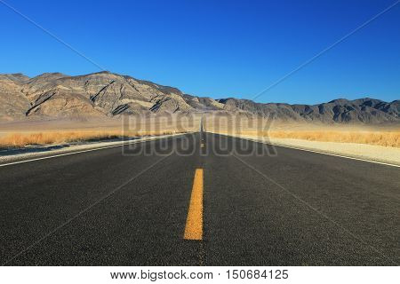 Great American road crossing a huge Death Valley in Nevada