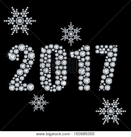 The new 2017 year diamond on a black background and snowflakes