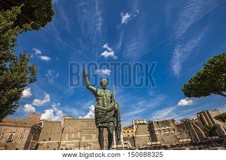 Caesar Octavian Augustus Statue In Front Of Ancient Trajan's Market In Rome