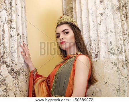woman in traditional roman clothing posing in temple
