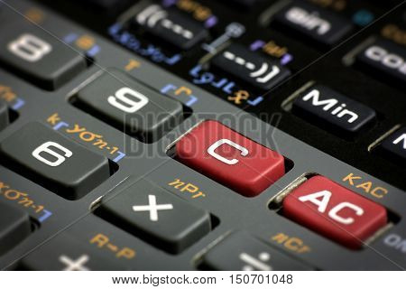 Scientific calculator clear and reset buttons close up with vignette