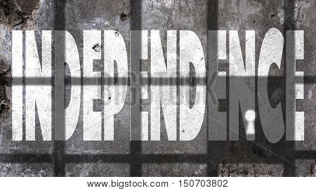 Independence Written On A Wall With Jail Bars Shadow