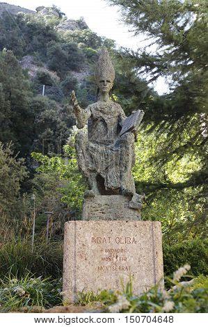 Statue abat Olibe (fundator of Montserrat) at the monastery the Benedictine Abbey Santa Maria de Montserrat near Barcelona Catalonia Spain
