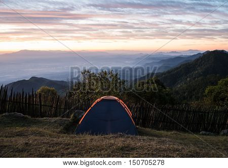 Tourist camp in a mountains with sun rise.