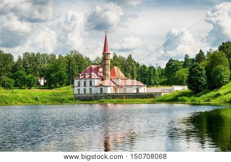 Priory palace in Gatchina building reflected in a lake
